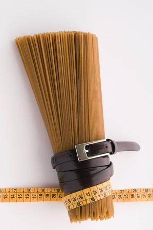 wholegrain spaghetti and belt and measure photo