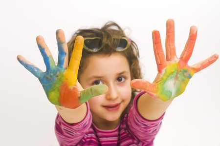 kids painted hands: cute girl with hands painted