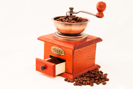 Retro coffee mill and grains on white background Stock Photo