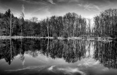 simetry: Reflection mirror lake,Vitosha mountain,Bulgaria Stock Photo