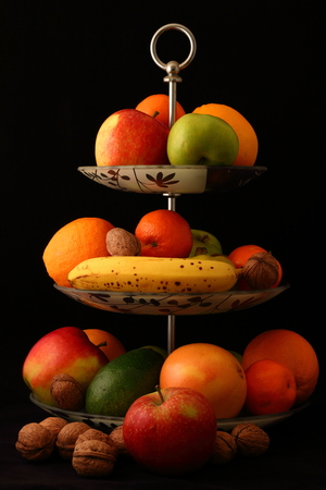 fruit mix: fruit mix in plate  on black background