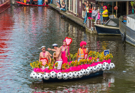 Amsterdam, August 5 2017: smallesr boat of the 2017 Canal parade sailing over the canals of the Prinsengracht in the center of Amsterdam Editorial
