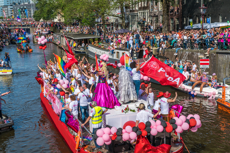 Amsterdam, August 5 2017: PVDA Boat at the 2017 Canal parade sailing over the canals of the Prinsengracht in the center of Amsterdam Editorial