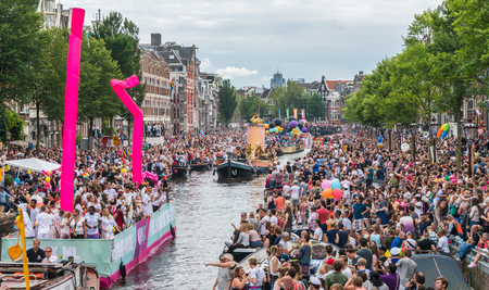 Amsterdam, August 5 2017: Boats of the 2017 Canal parade sailing over the canals of the Prinsengracht in the center of Amsterdam Editorial