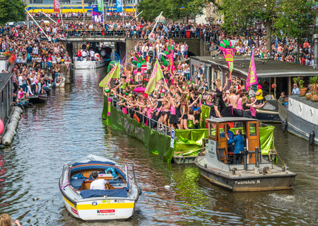canal parade: Amsterdam, August 5 2017: Boats of the 2017 Canal parade sailing over the canals of the Prinsengracht in the center of Amsterdam Editorial