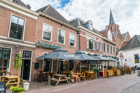 Amersfoort, the Netherlands July 22 2017: locals sitting at a terraces in front of restaurants in the old city of Amersfoort 에디토리얼