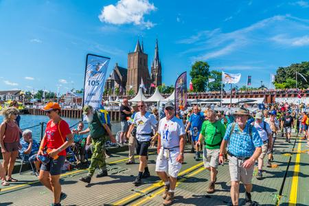 Nijmegen July 20 2017: 4Day Walking tournament contestants passing the church of the Village Cuijk Sajtókép