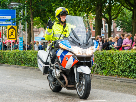 Nijmegen July 1 2017: Police motorcycle guiding the Flag parade of the 101st 4Day walk Editorial