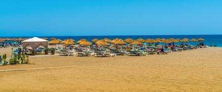 Benalmadena, Spain, june 27, 2017: Tourists lying on the Benalmadena beach near Malaga
