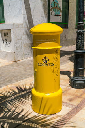 Benalmadena, Spain, june 30, 2017: Correos mail box on a shopping street Editorial