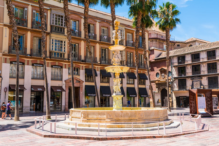 Malaga, Spain, June 27, 2017: Tourists and locals walking on the Plaza de la Constitución de Málaga