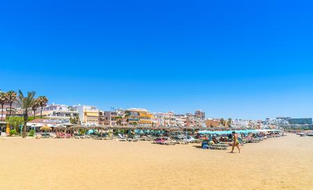 Benalmadena, Spain, june 29, 2017: Tourists lying on the Benalmadena beach near Malaga