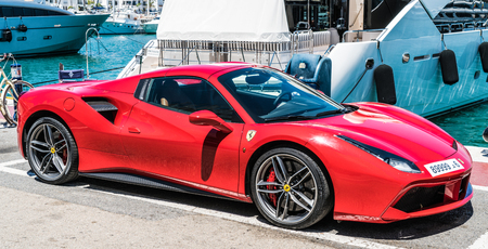 Puerto Banus, Spain, June 28 2017: red ferrari in the harbour