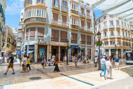 Malaga, Spain, June 27, 2017: Tourists and locals shopping at the Calle Marqués de Larios Editorial