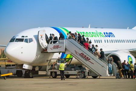Marrakech, Morocco May 20 2017: Passengers boarding a Boeing 737 or Transavia on the platform of the new Marrakech airport