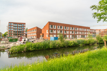 Amsterdam, The Netherlands, May 22 2017: The building of new houses and appartments in the west part of Amsterdam
