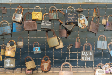 Krakau August 22nd 2017: several locks attached to the side of a bridge in Poland by tourists and locals to secure their love to each other
