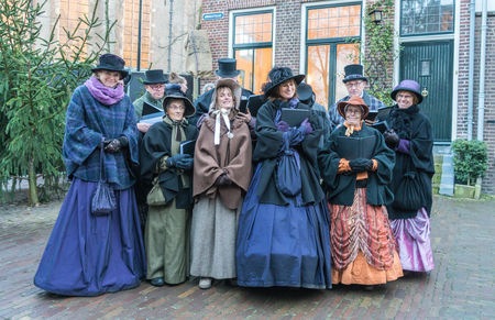 Deventer, the Netherlands, December 17th 2017: Choir of  dressed actors singing inside the Dickens festival