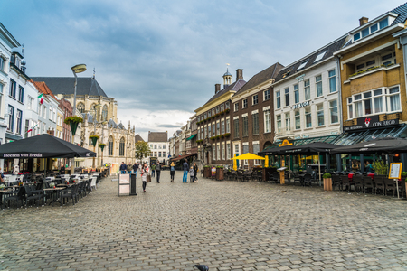 Breda, November 5th 2017: some locals walking in a shopping street in the old center