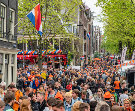 Amsterdam, The Netherlands, April 27 2018, Tourists and locals visiting the capital at the Prinsengracht to celebrate Kingsday