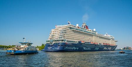 Amsterdam, May 7 2018 - Passengers sailing into the harbor of Amsterdam on a big German cruiseship of TUI Cruises Stok Fotoğraf - 106466591