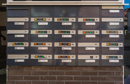 Harderwijk, The Netherlands May 5, 2018 - twenty one mailboxes of a appartment building with several stickers (Ja-Nee) to say what kind of leaflets and papers they want