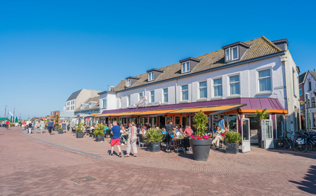 Harderwijk, The Netherlands May 5, 2018 - locals and tourist sitting on a terrace of restaurant Allure at the harborside of the city on a sunny liberation day