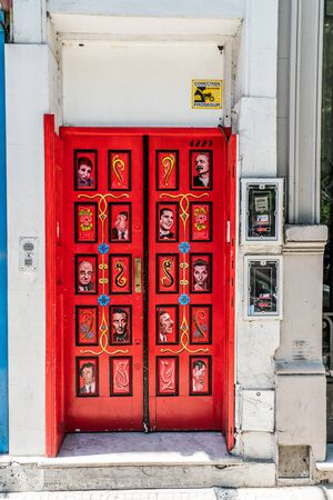 Red door with famous Argentinian peolpe at Recoleta, Buenos Aires, Argentina - January 23th 2019