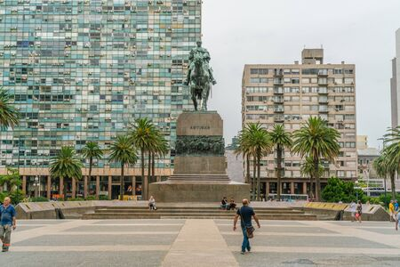 Tourists passing the statue of General Artigas on the Independance square (Plaza Indepencia), Montevideo, Uruguay, January 25th 2019