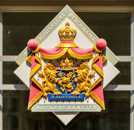 Utrecht, The Netherlands May 26 2018 - Shield on window of shop telling customers that the shop is a cout supplier by royal decicion (Hofleverandcier bij Koninklijke beschikking)
