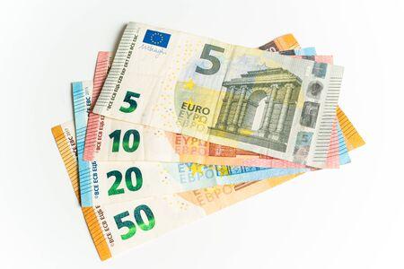 Four Euro bills. Five, ten, twenty and fifty Euros in a waver