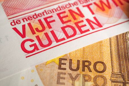 Fifty Euro and Twenty Five Guilders bill on top of each other to show the exchange between the two currencys