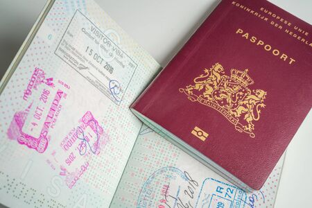 Dutch passport with stamps from diferent countrys like New Zealand, Peru, and USA New York Stock fotó - 131828635
