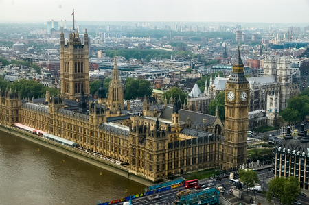 commons: LONDON, ENGLAND - MAY 3, 2007: Aerial view at Westminster Palace in London, England. Palace of Westminster is the meeting place of the House of Commons and the House of Lords.