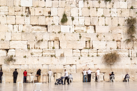 JERUSALEM, ISRAEL - APRIL 8, 2008: Unidentified people by the Western or Wailing wall in Jerusalem, Israel. The wall has been a site for Jewish prayer and pilgrimage for centuries.