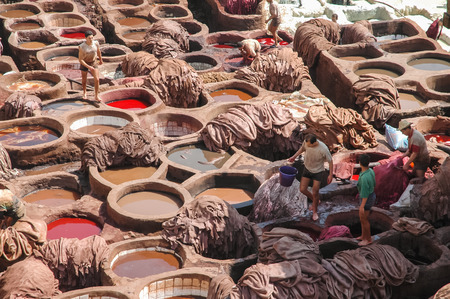 11th century: FES, MOROCCO - APRIL 29, 2006: Unidentified people working at tannery in Fes, Morocco. This is the oldest leather tannery in the world and has not changed since the 11th century.