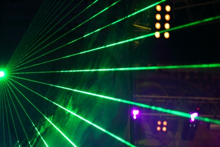 performace: laser show on a fate concert Stock Photo