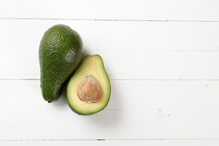 avacado: Avocado on a board painted with white paint Stock Photo
