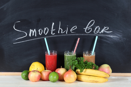 Fruit smoothies on a chalk board whith letters - Smoothie bar Archivio Fotografico