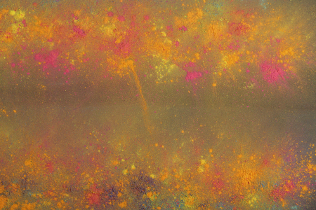 Holi colours on black background
