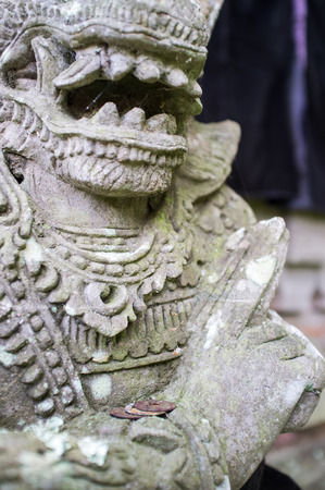 demoniacal: Ancient Balinese Temple Sculpture, Indonesia, Bali Stock Photo