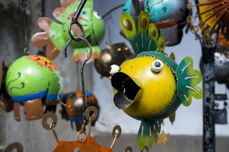 mementos: Souvenirs  (metal fish) for sale at the market in Ubud, Bali, Indonesia Stock Photo