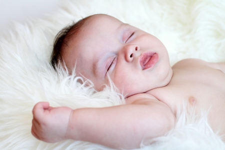 The baby sleeping on a fur plaid  3,5 months Stock Photo - 17420791