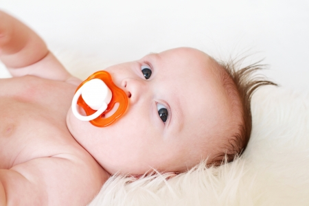 Portrait of the quiet baby with a baby s dummy  3,5 months   Stock Photo - 17420778
