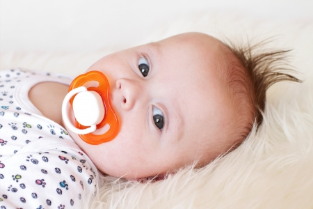 Portrait of the quiet baby with a baby s dummy  3,5 months Stock Photo - 17420774