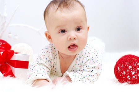 Portrait of the baby lying against gifts (3,5 months) Stock Photo - 17406003