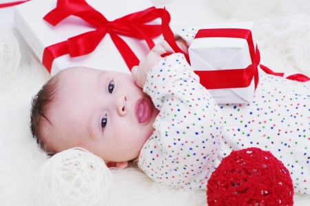 The baby with a gift in hands (3,5 months)  Stock Photo - 17405990