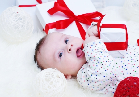 The baby with a gift in hands (3,5 months) Stock Photo - 17406028