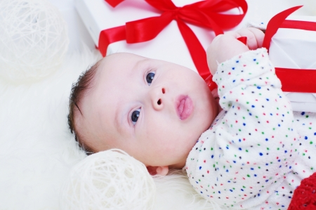 Portrait of the baby with a gift in hands Stock Photo - 17406020