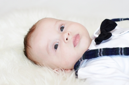 The baby in an elegant fashionable suit with a tie (4 months)  photo